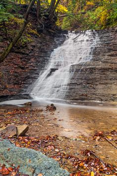 Buttermilk Falls, a waterfall in Cuyahoga Valley National Park, spills whitewater over a shale cliff with many tiny ledges in the autumn forest of Northeast Ohio. Please click the image to see more photography by Kenneth Keifer.