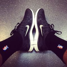 Marco Belinelli taking pictures of his shoes...again, lol. But seriously, I LOVE those shoes!