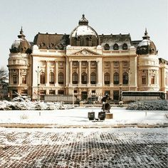 Turn-of-the-century University Library (former Royal Foundation) seen from the courtyard of the old Royal Palace in Bucharest, Romania, nowadays the Art Museum, on a sunny winter day. #bucuresti #bucharest #romania