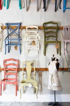 Painted chairs, hung on the wall