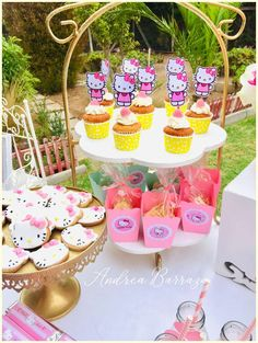 Loving the cookies and cupcakes at this Hello Kitty garden birthday party! See more party ideas and share yours at CatchMyParty.com #catchmyparty #partyideas #hellokitty #hellokittyparty #gardenparty #girlbirthdayparty #cupcakes #cookies