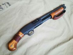 """Mossberg 590 """"Shockwave"""" with custom Wooden furnatureLoading that magazine is a pain! Get the F*ck over it and DO NOT get your Magazine speedloader today!but seriously, to Hell with that RAE Ind. Weapons Guns, Guns And Ammo, Mossberg Shockwave, Tactical Shotgun, Homemade Weapons, Fire Powers, Hunting Rifles, Cool Guns, Airsoft"""