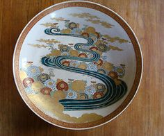 Classic Japanese artistry in this beautiful work of Satsuma pottery! Beautiful crackle glaze in the background, heavy gold appliqué in the flowers, beautiful blues, greens, reds and golds! The River of Life!