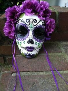Day of the Dead mask, inspiration!  Buy a $3 mask at craft store, paint, flowers and ribbon