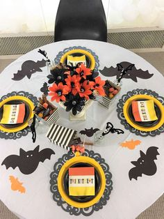 What fab table settings at this Halloween party!!! See more party ideas and share yours at CatchMyParty.com #halloween #tablesettings