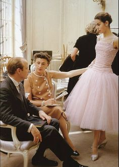 1954, Dior house model Odile wearing a tulle dress called 'Cuba' from Dior's autumn/winter collection. Photo by Mark Shaw.