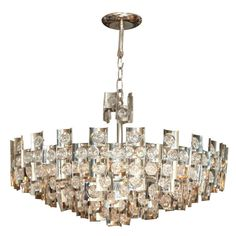 A Rare Magnified Crystal and Chrome Sciolari Chandelier | From a unique collection of antique and modern chandeliers and pendants  at https://www.1stdibs.com/furniture/lighting/chandeliers-pendant-lights/
