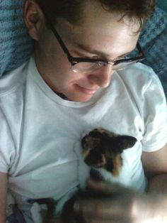 Boys with glasses with kittens