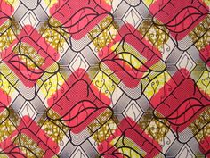 Hot Pink and Yellow African wax print batik fabric  100% cotton. £5.20, via Etsy.