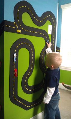 YES! Magnetic race track! Maybe just do one wall of the room to limit the green and blue paint. So awesome!