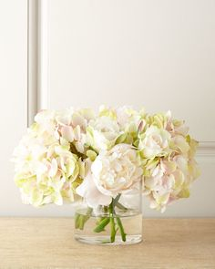 Handcrafted polyester peonies, roses, and hydrangeas in the palest of pinks and greens