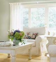 Frugal Cottage Ideas: This Maine cottage was transformed with custom-made furniture, antique quilts, and one-of-a-kind artwork. Use our ideas to create your own home sweet cottage for less. 1. Simple window treatments ensure ample light. Any lightweight cotton fabric will do. Find tab-top panels for less than $20 at Target or Bed Bath & Beyond. Or simply hem all raw fabric-by-the-yard edges and use clip-style curtain rings over rods for an easy project. 2. Slipcovers reflect the easy-living attitude that's crucial to cottage style. Sewn from affordable canvas, these slipcovers easily slip off and into the wash.