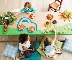 Make your snack table come alive with a few simple steps (and delicious treats)! Cover a table with butcher paper and paint it into the cutest buffet ever. Plan out your masterpiece according to your bowls and platters. Pizzas make great wheels, and silicone cupcake liners work perfectly as caterpillar cookie stands.