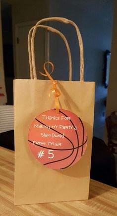 I created a template to make these SIMPLE goodie bags. I bought some stock paper, ribbon and a hand held hole punch and these CUTE simple gift bags to go with my sons basketball theme party!  Easy peasy!