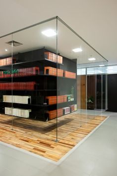 hanging book case in a glass room #lawoffice #design