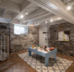 Just Basements is Ottawa's leading basement design build, basement renovation firm. Just Basements only specializes in designing and finishing great basements. Basement Renovations, Loft Style, Ottawa, Building Design, Playroom, Patio, Basements, Outdoor Decor, Stone