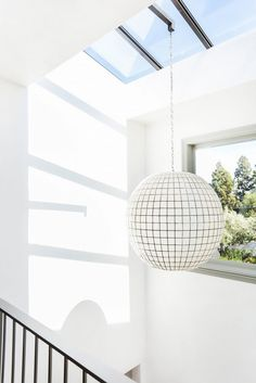 Skylight in white room with modern light fixture