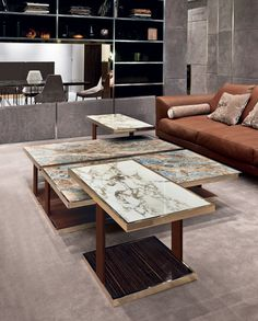 Longhi Layer Table. Calacatta Gold and Blue Jeans Marble. Ebony Base. Leather Side. Bright Gold Frame