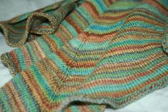 Forester Knitted Shawl A triangle shape but with longer ends due to increases in middle on RS only in middle and increase on each outer side on both sides.It stays on your shoulders, with longer ends to wrap around and fall to the front. Fingering on 3.75mm/5. Nice easy pattern.