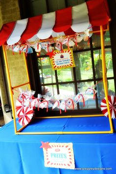 GreyGrey Designs: {My Parties} TJ and Taylor's Circus Birthday Party. I displayed the favors under this adorable tabletop tent from Oriental Trading. It was the perfect way to tie them all up like a carnival games booth!