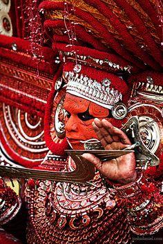 Muchilottu Bhagavathi Theyyam performer with a sword | Kannur, Kerala, India