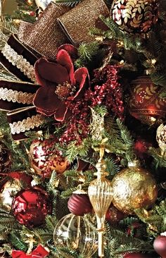 Our curated Imperiale Collection dresses your tree in immaculately detailed works of art. In traditional burgundy and gold, these exclusive glass ornaments are painted or embellished by hand with sequins, crystals, beads and faux pearls, in classic floral, damask, scroll and laurel branch designs.