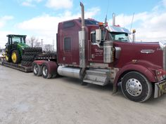 Purple Freightliner lowboy from Tri Green Tractor in Flora with a John Deere 8360R on board