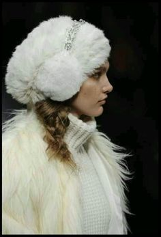 Jewelled ear muffs and furry hat.
