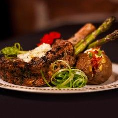 Bone in Prime Rib eye with house compound butter - loaded baked potato - roasted asparagus