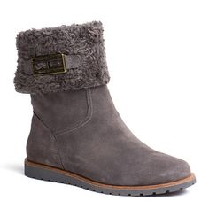 Trend-perfect ankle boot. Soft suede upper with flipped synthetic fur cuff. Tommy Hilfiger metal flag on the cuff. Synthetic fur lining throughout. Rubber outsole with 2cm heel height.