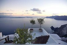 House with breathtaking views of sea and volcano in Oia, on the island of Santorini, Greece.