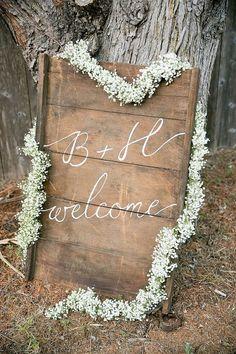 Baby's Breath Garland Welcome Sign / http://www.deerpearlflowers.com/rustic-budget-friendly-gypsophila-babys-breath-wedding-ideas/