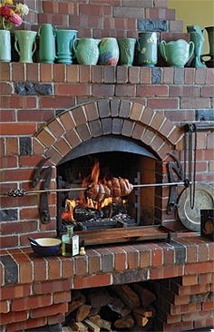Right around the corner from the big island, a fireplace with a rotisserie is th. - Decoration Fireplace Garden art ideas Home accessories Fireplace Kits, Modern Fireplace, Brick Fireplace, Fireplace Design, Indoor Grill, Indoor Pizza Oven, Outdoor Oven, Indoor Outdoor, Barbecue Four A Pizza