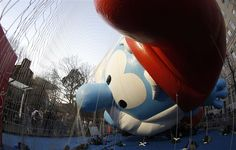 Papa Smurf by Carlo Allegri: A balloon being inflated with helium ahead of the Macy's Thanksgiving Parade in New York. #Thanksgiving #Macys__Parade