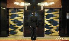 Elevator doors on the lobby level are dressed in op-art silk featuring a lightening-bolt motif. Hotel Okura in Tokyo, Japan.