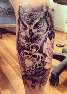 Realistic owl calf tattoo