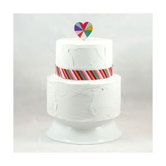 summer wedding cake ideas. rainbow heart topper