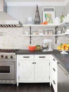 Marble backsplash, open shelving, gray horizontal bead board.