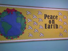 """""""Peace on Earth"""" is a lovely title for a holiday bulletin board display.  I like how the teacher has placed red bows around the Earth and used doves, the international sign of peace, as part of her Christmas bulletin board display."""