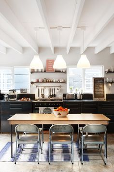 The more and more I see of dark cabinets on the bottom half of a kitchen paired with a light upper half, the more and more I like it.