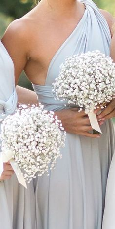 Baby breath bouquets for the maids, tied with black satin ribbon