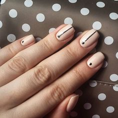 Try these easy-to-master minimal nail art designs from @Stylecaster | nude with black stripes and dots