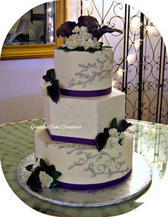 Image from http://akhta.com/wp-content/uploads/2015/04/purple-and-silver-wedding-cakes-amazing.jpg.