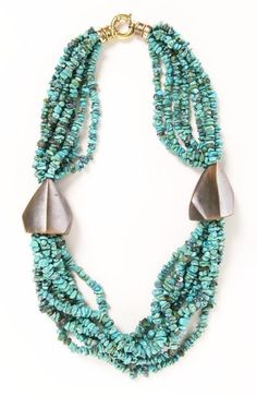 Multi strong necklace- I like how the large bead keeps all the strands neat.