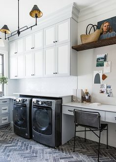 gray laundry rooms Stacked laundry room cabinets finished in white and gray bring a two-toned design styled with a home office extension. Garage Laundry, Mudroom Laundry Room, Laundry Room Cabinets, Farmhouse Laundry Room, Laundry Room Design, Home Office, White Laundry Rooms, Small Laundry, Kitchenette