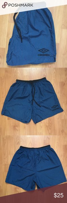 Vtg. Umbro Embroidered Spell Out Soccer Shorts Vintage Umbro Embroidered Spell Out Soccer Drawstring Shorts. Black and blue checkered. Small hole along seam of back pocket, can be easily fixed. Not noticeable when wearing. Great pair of vintage shorts! Size Large! Umbro Shorts Athletic