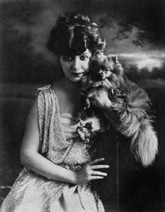 Edna Mayowith a Pomeranian pal, 1916