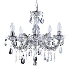 Marie Therese Silver Chandelier This new style 5 light Marie Therese chandelier from Litecraft is finished in silver and features stunning clear acrylic hanging pendants hung from a decorative frame. Light, Black Chandelier, Chandelier Ceiling Lights, Silver Chandelier, Lighting, Chandelier Uk, Chandelier, Chrome Chandeliers, Ceiling Lights
