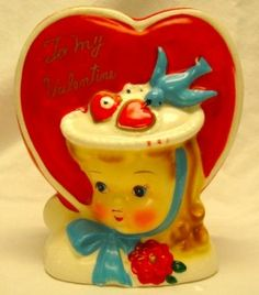 A darling vintage bluebird Valentine's Day themed planter. I saw one of these once and have regretted not buying it ever since!