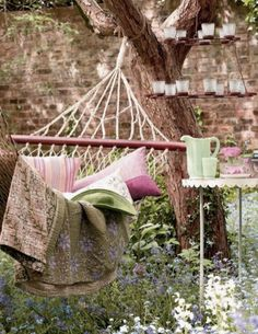 I love the hanging candles in the top right corner! Vintage Outdoor Hammock Ideas